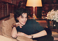 1986 FILE PHOTO - ARCHIVES -<br /> <br /> Model Ines de la Fressange curls up on a couch in Coco Chanel's Paris apartment wearing a cashmere sweater <br /> <br /> 1986<br /> <br /> PHOTO :  Erin Comb - Toronto Star Archives - AQP