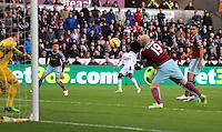 Pictured: Nathan Dyer of Swansea (C) watches on as team mate Bafetimbi Gomis is brought down by James Collins of West Ham thus failing to head the ball in Saturday 10 January 2015<br /> Re: Barclays Premier League, Swansea City FC v West Ham United at the Liberty Stadium, south Wales, UK