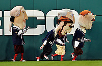 16 May 2012: The Washington Nationals Racing Presidents entertain fans between inning of a game against the Pittsburgh Pirates at Nationals Park in Washington, DC. The Racing Perogies joined the race as well. The Nationals defeated the Pirates 7-4 in the first game of their 2-game series. Mandatory Credit: Ed Wolfstein Photo