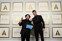 Michael Govier and Will McCormack pose backstage with the Oscar® for Animated Short Film during the live ABC Telecast of The 93rd Oscars® at Union Station in Los Angeles, CA on Sunday, April 25, 2021.<br /> *Editorial Use Only*<br /> ©A.M.P.A.S.<br /> Image supplied by Capital Pictures