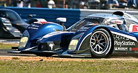 19 March 2011: The #8 Peugeot 908 of Stephane Sarrazin, Franck Montagny, and Pedro Lamy leads another car during the 12 Hours of Sebring, Sebring Internatonal Raceway, Sebring, FL. (Photo by Brian Cleary/www.bcpix.com)