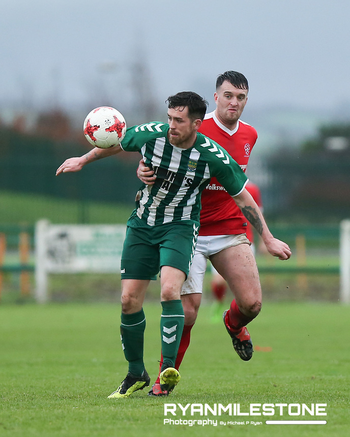 John Connery of St Michael's in action against Colum Treacy of Newmarket Celtic during the FAI Junior Cup 6th Round game between St Michael's and Newmarket Celtic  on Sunday 13th January 2019 at Cooke Park, Tipperary Town, Co Tipperary. Mandatory Credit: Michael P Ryan.