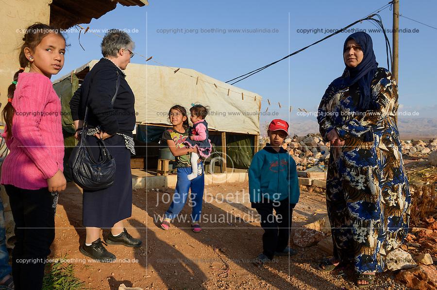 LEBANON Deir el Ahmad, a maronite christian village in Beqaa valley, syrian refugee camp / LIBANON Deir el Ahmad, ein christlich maronitisches Dorf in der Bekaa Ebene, Good Shepherds Sisters der maronitischen Kirche, Schwester Amira Tabet im Camp fuer syrische Fluechtlinge, mit Soumaya Alkhatib, die Mutter des Jungen Ahmad, er hat heute seinen 11. Geburtstag, er ist mit seiner Familie aus Homs geflohen