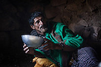Man drinking fermented milk in his hut. Dixam, the Haguier mountains.