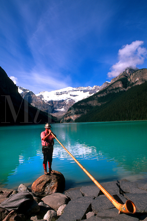 Swiss Alphorn player at Lake Louise in Banff Canada.