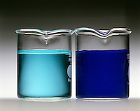 TRANSITION METAL COMPLEX SOLUTIONS (2 of 2)<br /> Copper and Cobalt<br /> (left) Solution of blue Cu(NO3)2*6H2O (complex ion is Cu(H2O)6 +2).  (right) Addition of NH3(aq) forms deep blue complex ion [Cu(NH3)4(H2O)2]2+.
