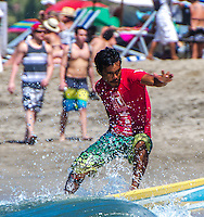 Sports, Photograph of a surfer catching the waves at Sayulita, beach in Nayarit, Mexico.