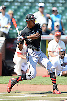 Infielder Jacob Gatewood (13) of Redwood High School in Visalia, California during the home run derby before the Under Armour All-American Game on August 24, 2013 at Wrigley Field in Chicago, Illinois.  (Mike Janes/Four Seam Images)