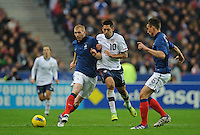Jeremy Mathieu of France, Clint Dempsey of team USA and Laurent Koscielny of France fight for the ball during the friendly match France against USA at the Stade de France in Paris, France on November 11th, 2011.