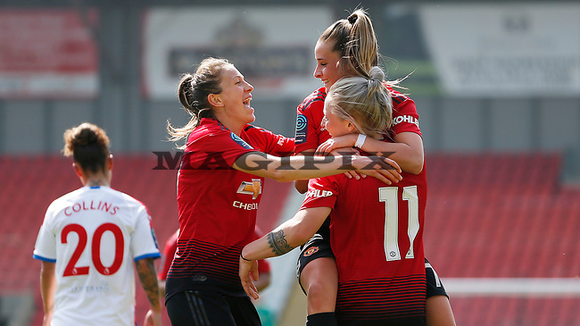 Leah Galton of Manchester United Women puts the ball in the net for the 3rd goal...cele with Ella Toone of Manchester United Women on top and Lizzie Arnot of Manchester United Women[lft]