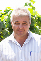 Pero Vucic viticulturist and vineyard manager in the vineyard. One of their best vineyards with very poor soil on a hilltop mountain near Citluk and Zitomislic. Vinarija Citluk winery in Citluk near Mostar, part of Hercegovina Vino, Mostar. Federation Bosne i Hercegovine. Bosnia Herzegovina, Europe.