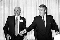 """Dorval (Qc) CANADA - July 15, 1984 File Photo-<br /> PC leader Brian Mulroney (L) and <br /> Bob Layton (Late father of NDP Leader Jack Layton) seen in file photo campaigning as the  Progressive-Conservative candidate for Lachine in the 1984 federal election. Photo was taken at the presentation of Montreal's PC Candidates.<br /> <br /> Robert Edward John """"Bob"""" Layton, PC (December 25, 1925 Ò May 9, 2002) was a Canadian politician.<br /> <br /> Robert Layton was born in Montreal, and graduated from McGill University in 1947. He spent much of his professional career running an engineering consulting business in Montreal, Quebec.<br /> <br /> The son of former Quebec cabinet minister Gilbert Layton, he became a political activist for the Liberal Party of Canada, running unsuccessfully for the party's nomination for a seat in the Canadian House of Commons.<br /> <br /> In the 1980s, he joined the Progressive Conservative Party of Canada, and was elected to the Federal Parliament in the 1984 election from the Quebec riding of Lachine. He served as Minister of State for Mines in the federal cabinet of Prime Minister Brian Mulroney from 1984 to 1986.<br /> <br /> He was re-elected to the House of Commons in the 1988 election, and retired from politics in 1993.<br /> <br /> Layton married Doris Elizabeth Steeves, a grand-niece of father of confederation William Steeves. Layton's son, Jack Layton is the current leader of the New Democratic Party."""