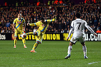Swansea, UK. Thursday 20 February 2014<br /> Pictured: Blerim Djemaili of Napoli (C) takes a shot which goes wide<br /> Re: UEFA Europa League, Swansea City FC v SSC Napoli at the Liberty Stadium, south Wales, UK
