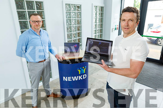 Ken Tobin (Tralee Chamber Alliance) with Robert Carey (NEWKD) pictured on Saturday, who are helping students gain access to laptops during the Covid-19 pandemic.