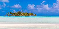 Paradisiac coconut trees and white sand motu in the turquoise lagoon of Rangiroa atoll, Tuamotu archipelago, French Polynesia, South Pacific Ocean