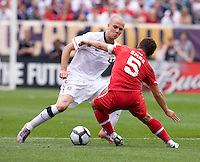 Michael Bradley (4) of the USMNT takes the ball away from Emre Belozoglu (5) of Turkey at Lincoln Financial Field in Philadelphia, PA.  The USMNT defeated Turkey, 2-1.