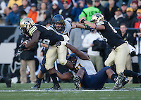 California defender Deandre Coleman tackles Colorado tailback Christian Powell during the game at Folsom Field in Boulder, Colorado on November 16th, 2013.  Colorado defeated California, 41-24.