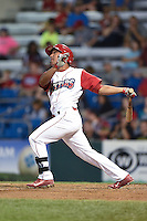 Williamsport Crosscutters outfielder Jiandido Tromp (23) hits a home run during a game against the Aberdeen IronBirds on August 4, 2014 at Bowman Field in Williamsport, Pennsylvania.  Aberdeen defeated Williamsport 6-3.  (Mike Janes/Four Seam Images)