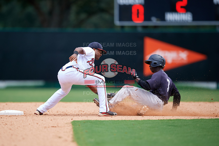 GCL Braves second baseman Luis Ovando (7) tags out Sincere Smith (3) trying to steal second base during the second game of a doubleheader against the GCL Yankees West on July 30, 2018 at Champion Stadium in Kissimmee, Florida.  GCL Braves defeated GCL Yankees West 5-4.  (Mike Janes/Four Seam Images)