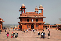 Fatehpur Sikri, Uttar Pradesh, India.   Courtyard in front of the Diwan-i-Khas (Hall of Private Audience) of Emperor Jalal el-Din Akbar.  Chhatris on Corners of Roof.
