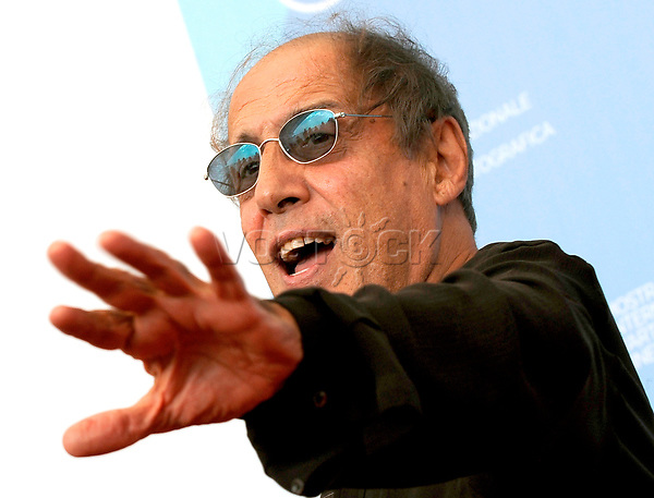 epa01477198 Italian actor, director, singer and showman Adriano Celentano poses for photographers after the press conference for his restored film 'Yuppi Du' presented out of competition at the 65th International Film Festival of Venice, 04 September 2008, in Venice, Italy. The festival is scheduled for 27 August to 06 September 2008.  EPA/CLAUDIO ONORATI