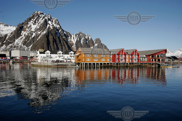 Hotels and and old fish recetion center in Svolvær harbour. Cod fishing is a traditional practice in Lofoten, home to around 24,500 people and and an area where locals have been producing Stockfish for over 1000 years. Lofoten is where the World's largest and last cod stocks are found, in the Barent's Sea. Fishing is as strong an industry as tourism in this region.