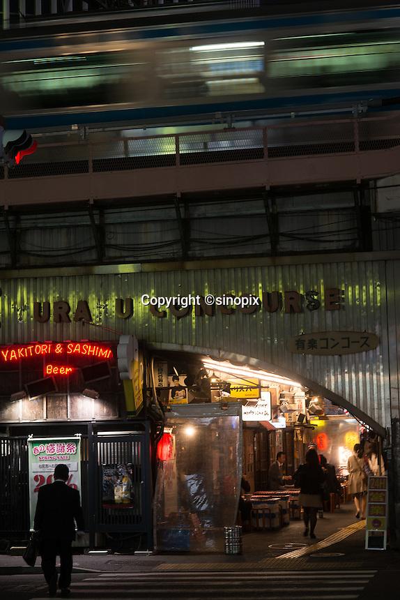 Salaryman enjoy drinking at the bars under the railway track  at Shinbashi station