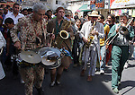 """Members of a French band named """"Musica Brass"""" perform a music showing  for Palestinians in the the West Bank city of Ramallah on June 21, 2009. Photo by Issam Rimawi"""