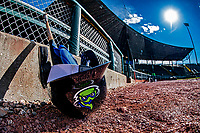 29 May 2021: A Vermont Lake Monsters Batting Helmet and bat lie outside the dugout prior to a game against the Norwich Sea Unicorns at Centennial Field in Burlington, Vermont. The Lake Monsters defeated the Unicorns 6-3 in their FCBL Home Opener, the first home game played at Centennial Field post-Covid-19 pandemic. Mandatory Credit: Ed Wolfstein Photo *** RAW (NEF) Image File Available ***