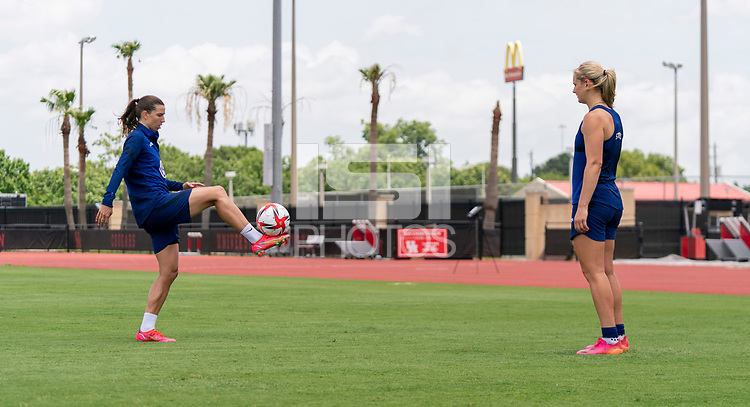 HOUSTON, TX - JUNE 8: Tobin Heath #17 and Lindsey Horan #9 of the USWNT juggle the ball after a training session at the University of Houston on June 8, 2021 in Houston, Texas.