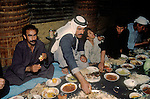 Marsh Arabs. Southern Iraq.  Banquet taking place in traditional village reed constructed building called a Mudhif. Only male members of community attended. Haur al Mamar or Haur al-Hamar marsh collectively known now as Hammar marshes Iraq 1984