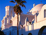 San Xavier Reservation, AZ  <br /> San Xavier del Bac Mission towers and domes at sunrise