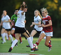 NWA Democrat-Gazette/ANDY SHUPE<br /> Arkansas' Stefani Doyle (17) pushes the ball past Vanderbilt's Hannah Menard Thursday, Oct. 6, 2016, during the first half of play at Razorback Field in Fayetteville. Visit nwadg.com/photos to see more photographs from the game.