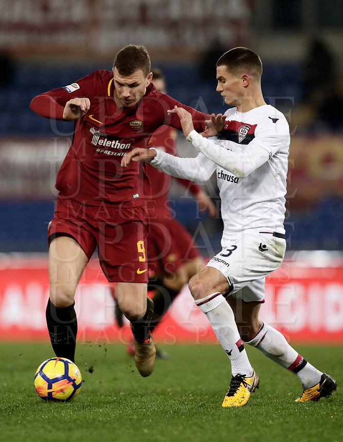 Calcio, Serie A: AS Roma vs Cagliari, Roma, stadio Olimpico, 16 dicembre 2017.<br /> Roma's Edin Dzeko (l)in action with Cagliari's Marco Andreolli (r) during the Italian Serie A football match between AS Roma and Cagliari at Rome's Olympic stadium, December 16, 2017.<br /> UPDATE IMAGES PRESS/Isabella Bonotto