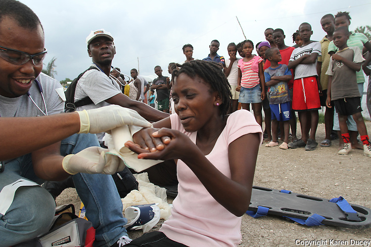 Emergency Medical Technician (EMT) students attend class at Bojeaux Park in Port au Prince, Haiti between September 12 and September 14, 2011 taught by volunteers from EMPACT Northwest.  The park is the site of a former medical clinic set up in the aftermath of the Hurricane that devastated Haiti almost 2 years ago.   The students will operate the Port Au Prince Medic One unit, believed to be the first of its kind run by Haitians in Haiti.  Empact Northwest is a non-profit based out of Washington state. (photo copyright Karen Ducey)