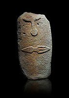 Late European Neolithic prehistoric Menhir standing stone with carvings on its face side. The representation of a stylalised male figure starts at the top with the bottom of a carving of a falling figure with head at the bottom and 2 curved arms encircling a body above. at the bottom is a carving of a dagger running horizontally across the menhir. Excavated from Piscina 'E Sali V site,  Laconi. Menhir Museum, Museo della Statuaria Prehistorica in Sardegna, Museum of Prehoistoric Sardinian Statues, Palazzo Aymerich, Laconi, Sardinia, Italy. Black background.