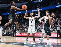 WASHINGTON, DC - JANUARY 28: Henry Baddley #20 of Butler lobs up  shot past Jagan Mosely #4 of Georgetown during a game between Butler and Georgetown at Capital One Arena on January 28, 2020 in Washington, DC.