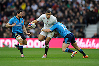 Luther Burrell of England looks to offload as he is tackled by Luca Morisi of Italy as Andrea Masi of Italy looks on during the RBS 6 Nations match between England and Italy at Twickenham Stadium on Saturday 14th February 2015 (Photo by Rob Munro)