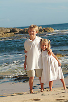 Brother and sister posing for a portrait on the beach on vacation in Hawaii