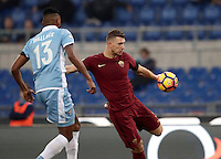 Calcio, Serie A: Lazio vs Roma. Roma, stadio Olimpico, 4 dicembre 2016.<br /> Roma's Edin Dzeko, right, kicks the ball past Lazio's Wallace during the Italian Serie A football match between Lazio and Rome at Rome's Olympic stadium, 4 December 2016. Roma won 2-0.<br /> UPDATE IMAGES PRESS/Isabella Bonotto