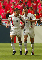 Claudio Reyna congratulates Clint Mathis after his goal. The USA tied South Korea, 1-1, during the FIFA World Cup 2002 in Daegu, Korea.