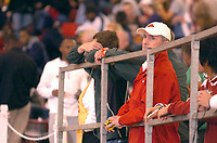 ANTHONY REYES Northwest Arkansas Times<br />Arkansas track coach John McDonnell watches the action Saturday at the Arkansas Invitational in the Randall Tyson Track Complex.