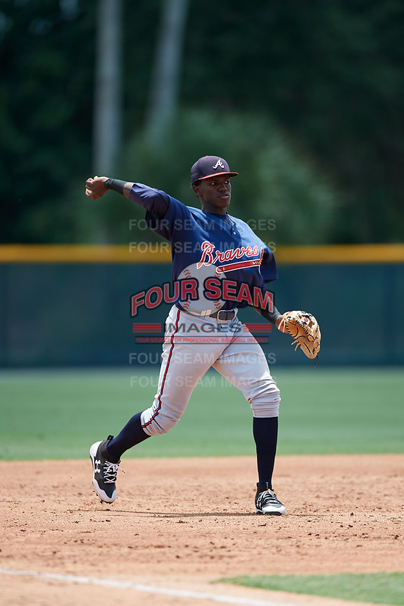 GCL Braves third baseman Jean Carlos Encarnacion (25) throws to first base during a game against the GCL Pirates on July 26, 2017 at Pirate City in Bradenton, Florida.  GCL Braves defeated the GCL Pirates 12-5.  (Mike Janes/Four Seam Images)