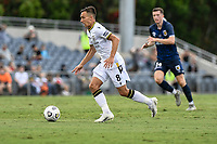 3rd January 2021; Campbelltown Stadium, Leumeah, New South Wales, Australia; A League Football, Macarthur FC versus Central Coast Mariners; Denis Genreau of Macarthur FC runs with the ball chased by Daniel Bouman of Central Coast Mariners