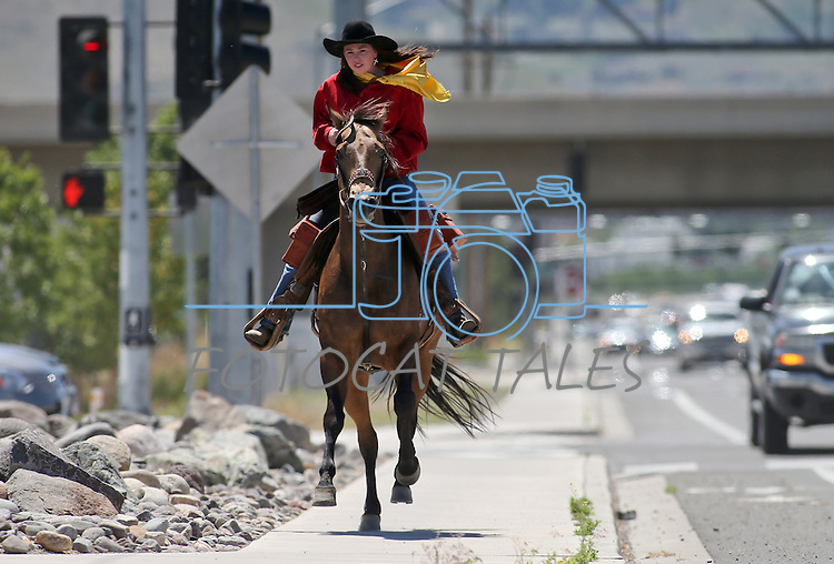 Catie Peralta, of Dayton, rides Dusty along Highway 50 during the annual Pony Express Re-ride through Carson City, Nev., on Thursday, June 12, 2014. (Las Vegas Review-Journal/Cathleen Allison)