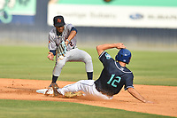 Bowling Green Hot Rods shortstop Greg Jones (2) attempts to field the ball as Matt Barefoot (12) slides into second base during a game against the Asheville Tourists on May 29, 2021 at McCormick Field in Asheville, NC. (Tony Farlow/Four Seam Images)