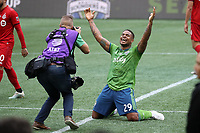 SEATTLE, WA - NOVEMBER 10: Roman Torres #29 of the Seattle Sounders FC raises his arms in triumph at final whistle during a game between Toronto FC and Seattle Sounders FC at CenturyLink Field on November 10, 2019 in Seattle, Washington.