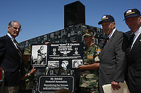 Jerry Coleman, (left) the voice of the San Diego Padres, receives a special plaque during Memorial Day ceremonies at the Mount Soledad Veterans Memorial, La Jolla, CA, USA Monday May 26 2008.  Coleman, who is a highly decorated WWII and Korean War pilot, said that the America's real heroes are all dead, referring to the many service members who lost their lives for the country.  Dr Bobby Brown and William J. Kellogg, are to the right of the plaque.