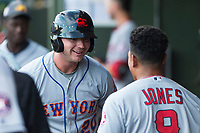 AFL East first baseman Peter Alonso (20), of the Scottsdale Scorpions and the New York Mets organization, prepares to receive a hug from second baseman Jahmai Jones (9) in the dugout after hitting a home run in the first inning during the Fall Stars game at Surprise Stadium on November 3, 2018 in Surprise, Arizona. The AFL West defeated the AFL East 7-6 . (Zachary Lucy/Four Seam Images)