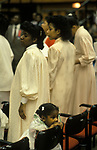 Black British church service London England UK 1990s child with parents bored during a long service. 90s England.